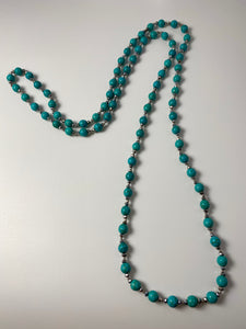 Long necklace, with interconnected turquoise stations.