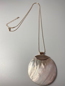 Long necklace, with natural shell pendant and rose gold coloured chain.