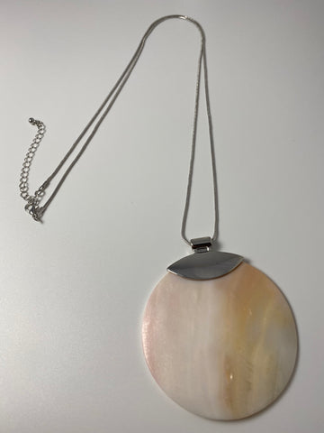 Long necklace, with natural shell pendant and silver coloured chain.