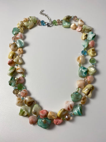 Short necklace, with two-row natural shell detail.