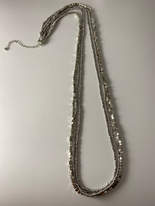 Long necklace, with three-row, multi-faceted detail.