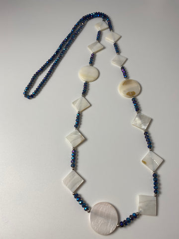 Long necklace, with mother of pearl stations and navy crystal components.