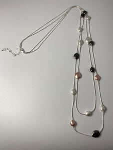 Long two-row necklace, with tri-tone circular stations.