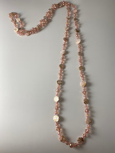 Long necklace, with rose gold-tone stations and pink beads.