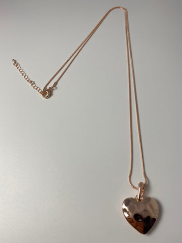 Long necklace, with rose gold battered metal heart pendant.