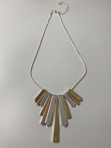Short necklace, with silver, rose gold and yellow gold tone droplets.