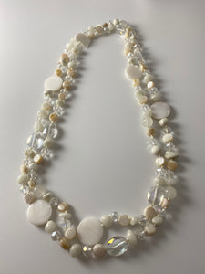 Short necklace, with mother of pearl cream-shell detailing.