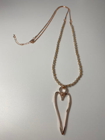 Long necklace, with open-heart pendant in rose-gold.