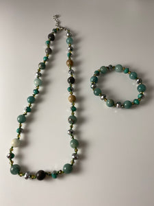 Short necklace, with green natural mother of pearl stations and matching bracelet.