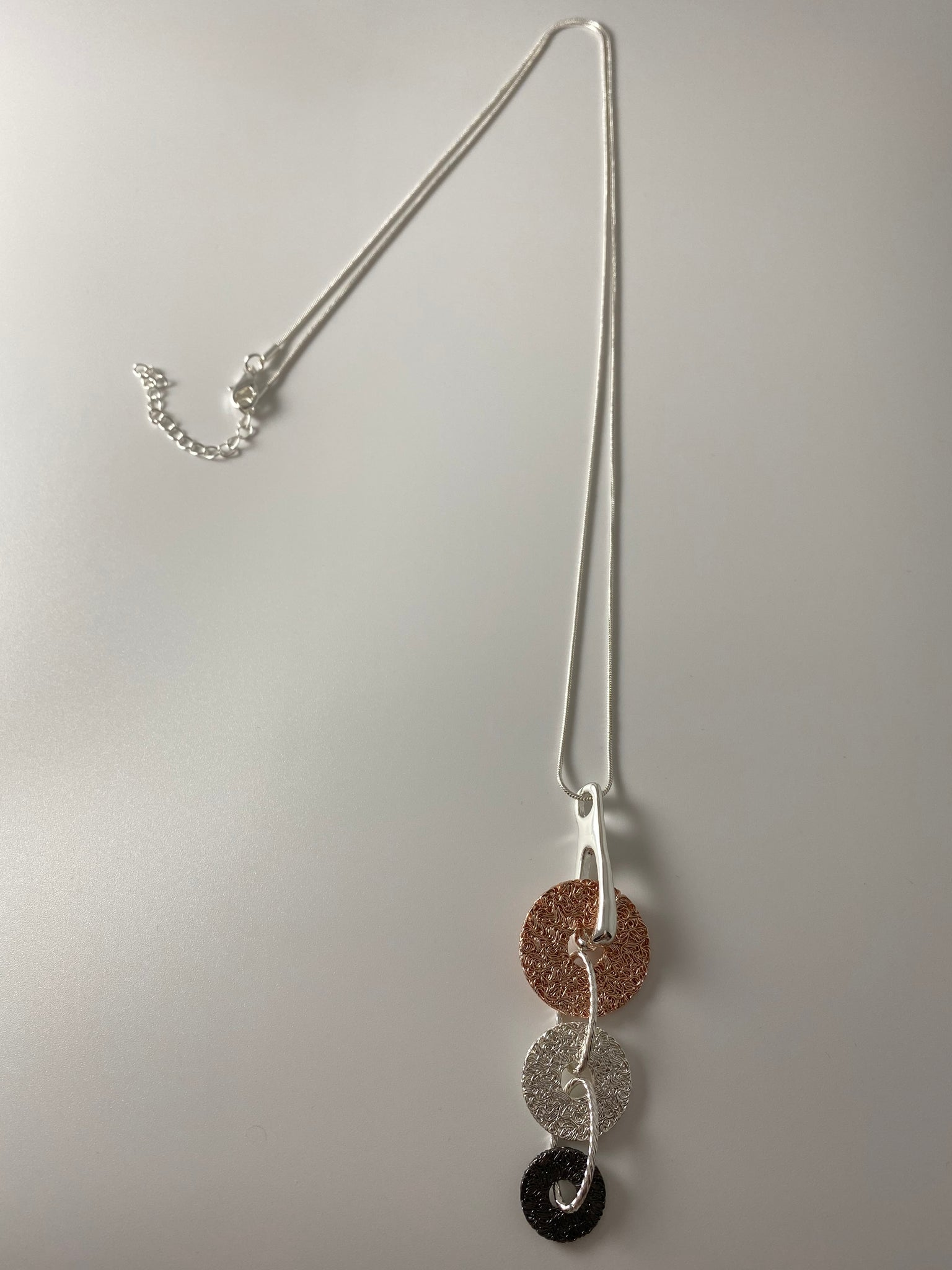 Long necklace, with tri-tone mesh discs.