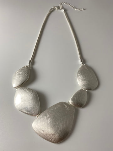 Short necklace, with brushed silver 'pebbles'.