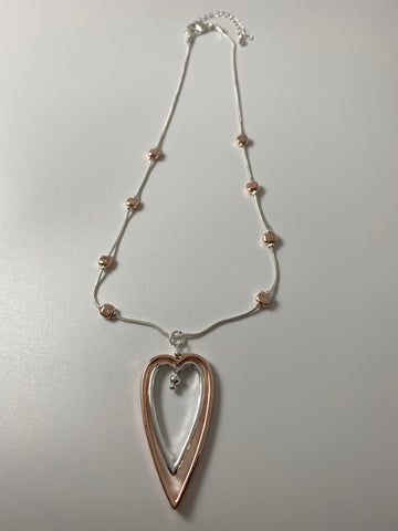Short necklace, with two-tone open heart pendant.