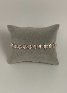 Elasticated heart bracelet in silver and rose gold