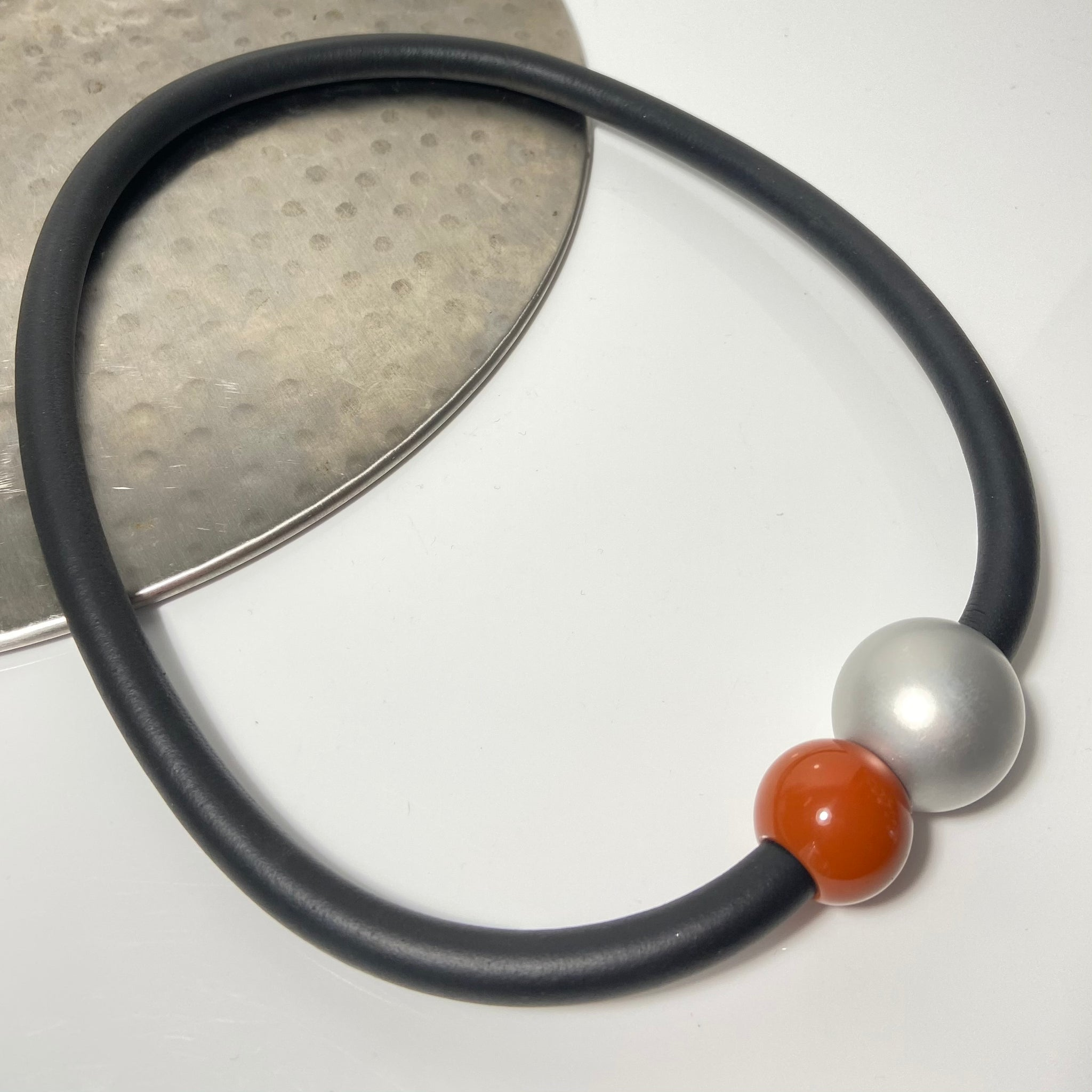 Short necklace, with tan coloured ball including rubber cord and magnetic ball