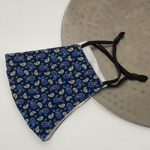 Blue paisley design face mask with adjustable earstrings