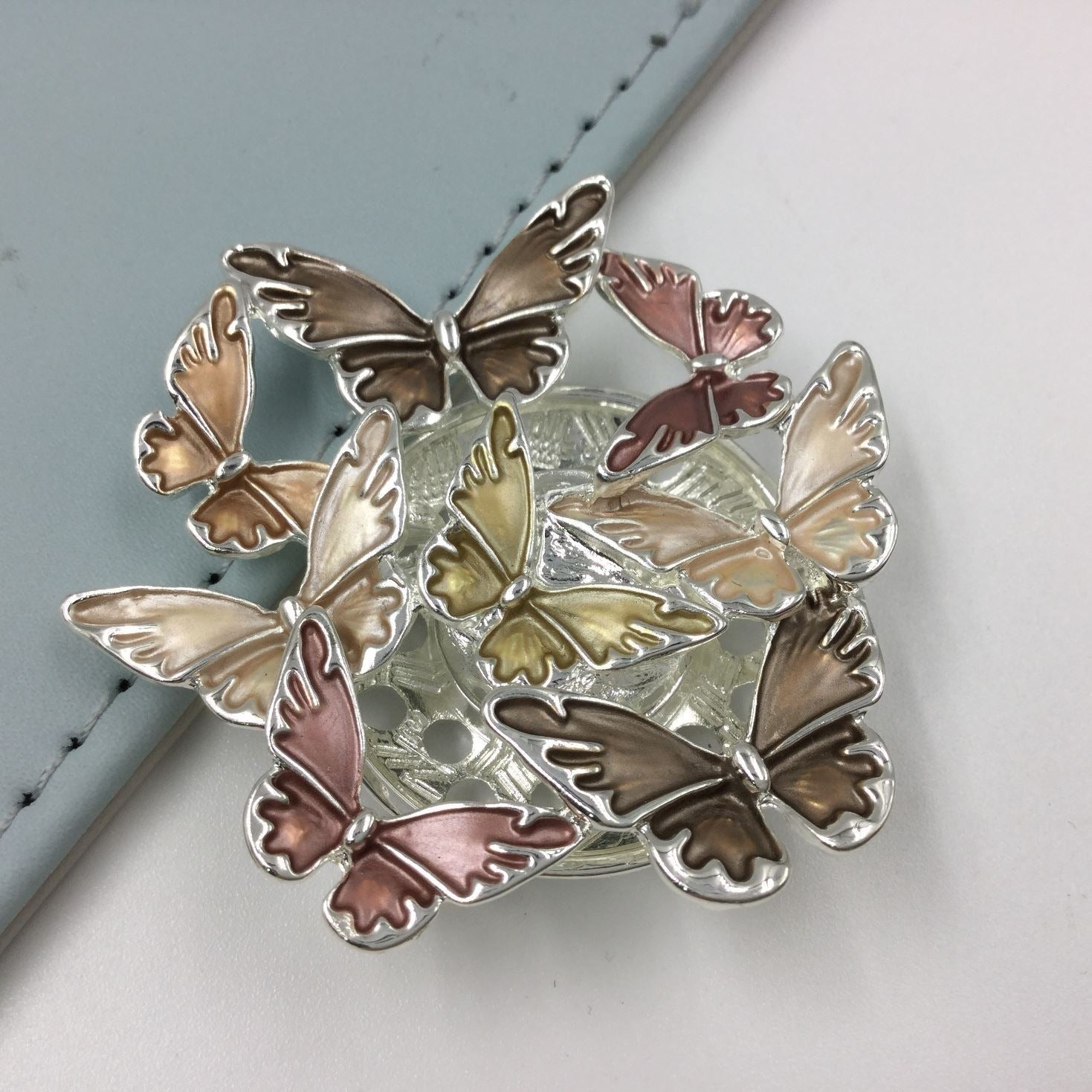 Circular butterfly design magnetic brooch