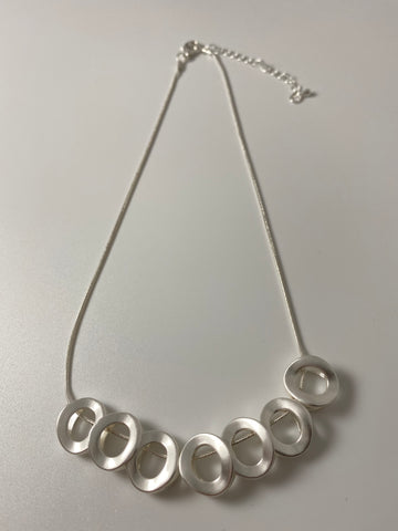 Short necklace, with silver tone oval stations