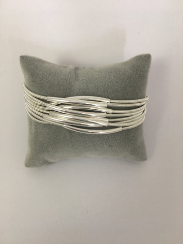 Magnetic bracelet, with multi-strand silver bar stations