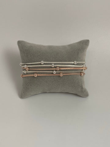 Magnetic bracelet, with two-tone beaded strands.