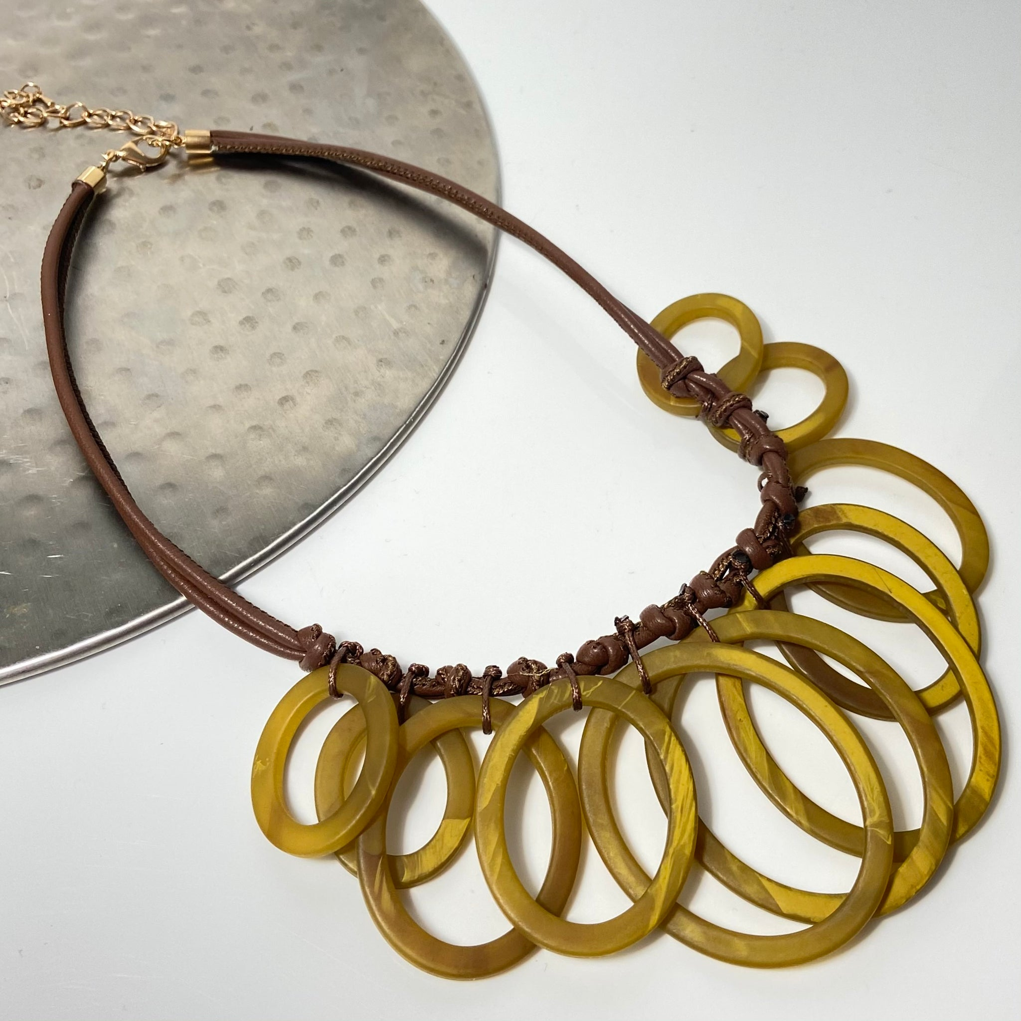 Short necklace, with mustard coloured loop stations