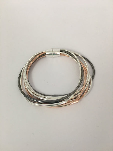 Magnetic bracelet, with multi-strand tri-tone bar stations