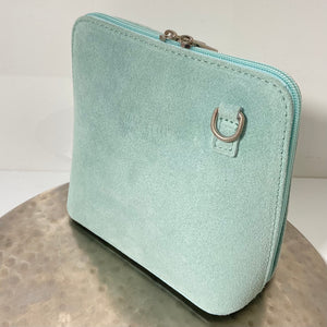 Mint green cross-body suede bag