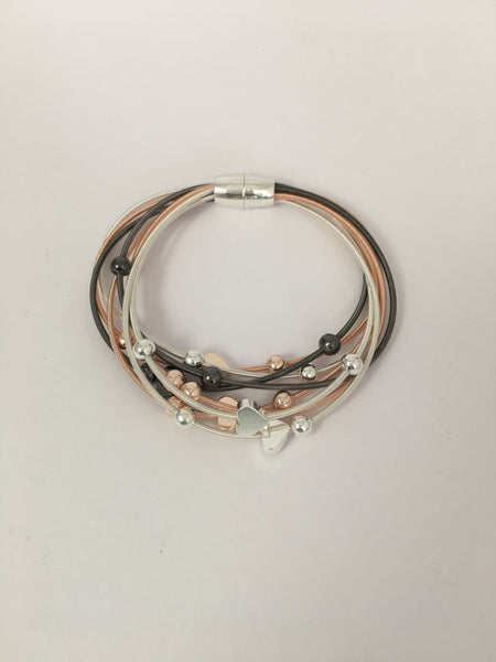 Magnetic bracelet, with multi-strand tri-tone heart stations
