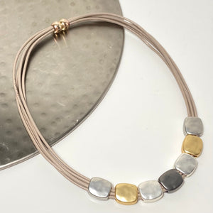 Short necklace, with rose gold, gold and silver tone nuggets with a magnetic clasp on taupe leather strands