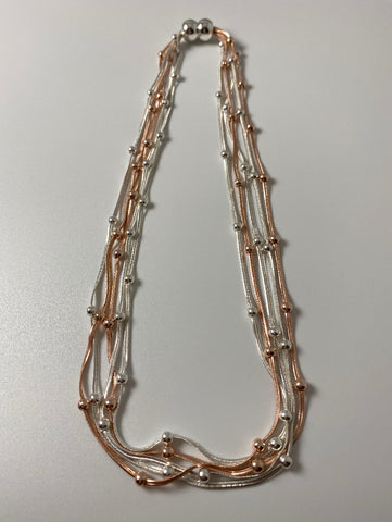 Short necklace, with multi-strand silver and rose gold tone chain, including a magnetic clasp