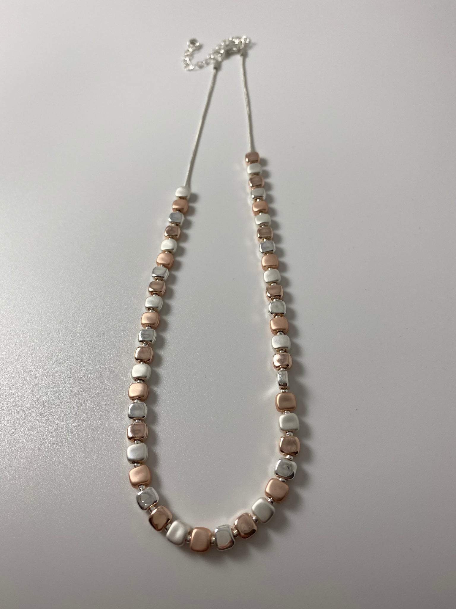 Short necklace, with silver and rose gold tone moveable square stations