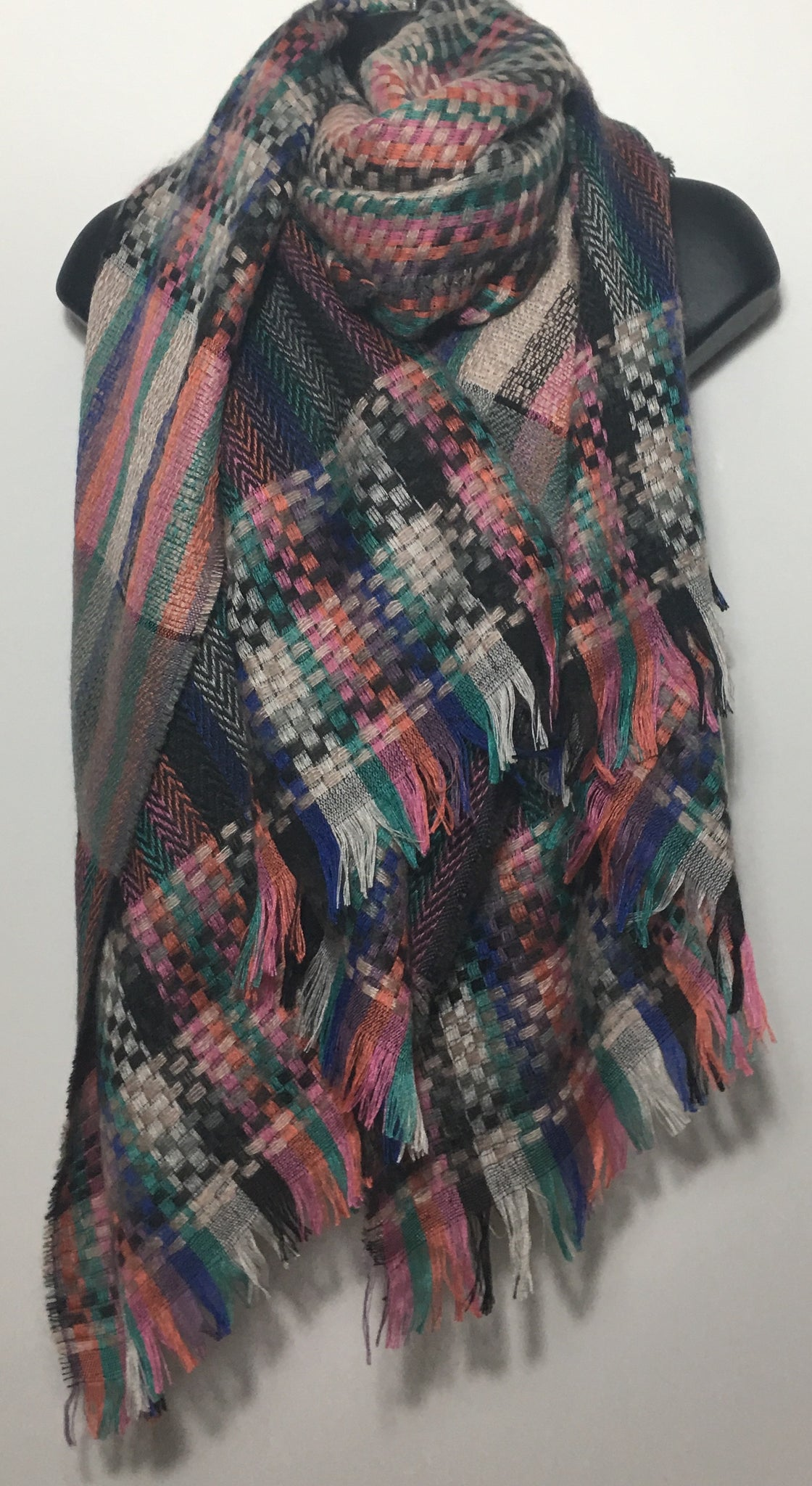 Abstract woven scarf in shades of pink green and blue