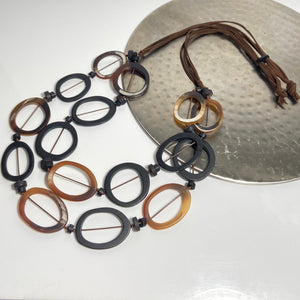 Adjustable necklace, with brown and white coloured circular stations
