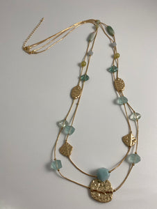 Long necklace, with two row gold tone stands and marine-blue glass faceted beads