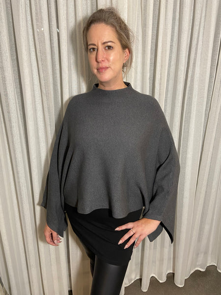 Luxurious soft poncho with diamanté ball embellishment in charcoal grey