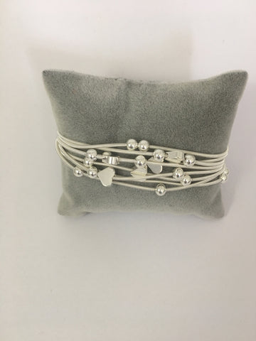 Magnetic bracelet, with multi-strand silver heart stations
