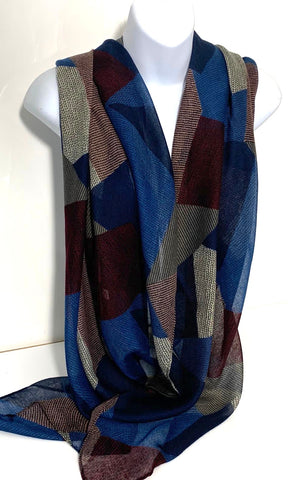 Geometric patterned scarf in blue, maroon and stone