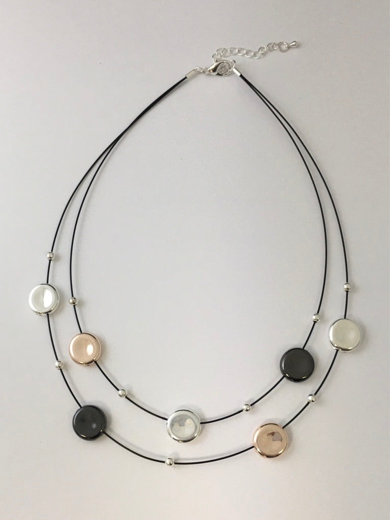 Short necklace, with two-tone stations on two-row wire.