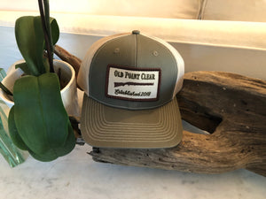 Grey green hat with tan SnapBack and gun patch