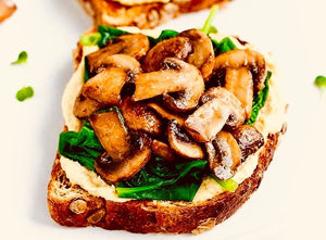 Toast with hummus and sautéed mushrooms