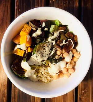 Buddha bowl with sprouted chickpeas and tahini sauce