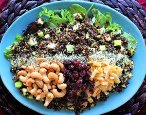 Curry quinoa salad with dried fruits and cashews