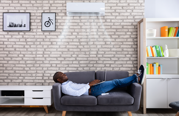 guy enjoying air conditioner on a hot day