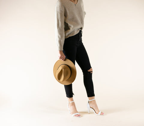 woman posing with white foot wear