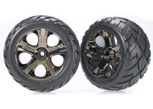 Traxxas Tires  and  wheels, assembled, glued (All-Star black chrome wheels, Anaconda tires, foam inserts) (nitro rear/ electric front) (1 left, 1 right)