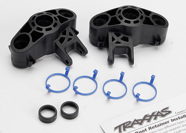Traxxas Axle carriers, left  and  right (1 each) (use with larger 6x13mm ball bearings)/ bearing adapters (for 6x12mm ball bearings) (2)/ dust boot retainers (4)