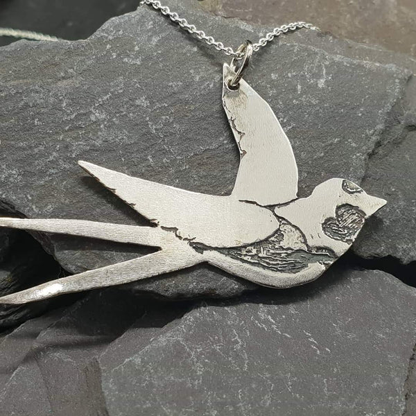 Swallow charity pendant