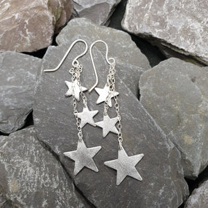 Dazzling dangly star earrings