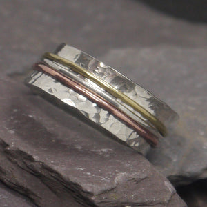 Three metal silver spinner ring