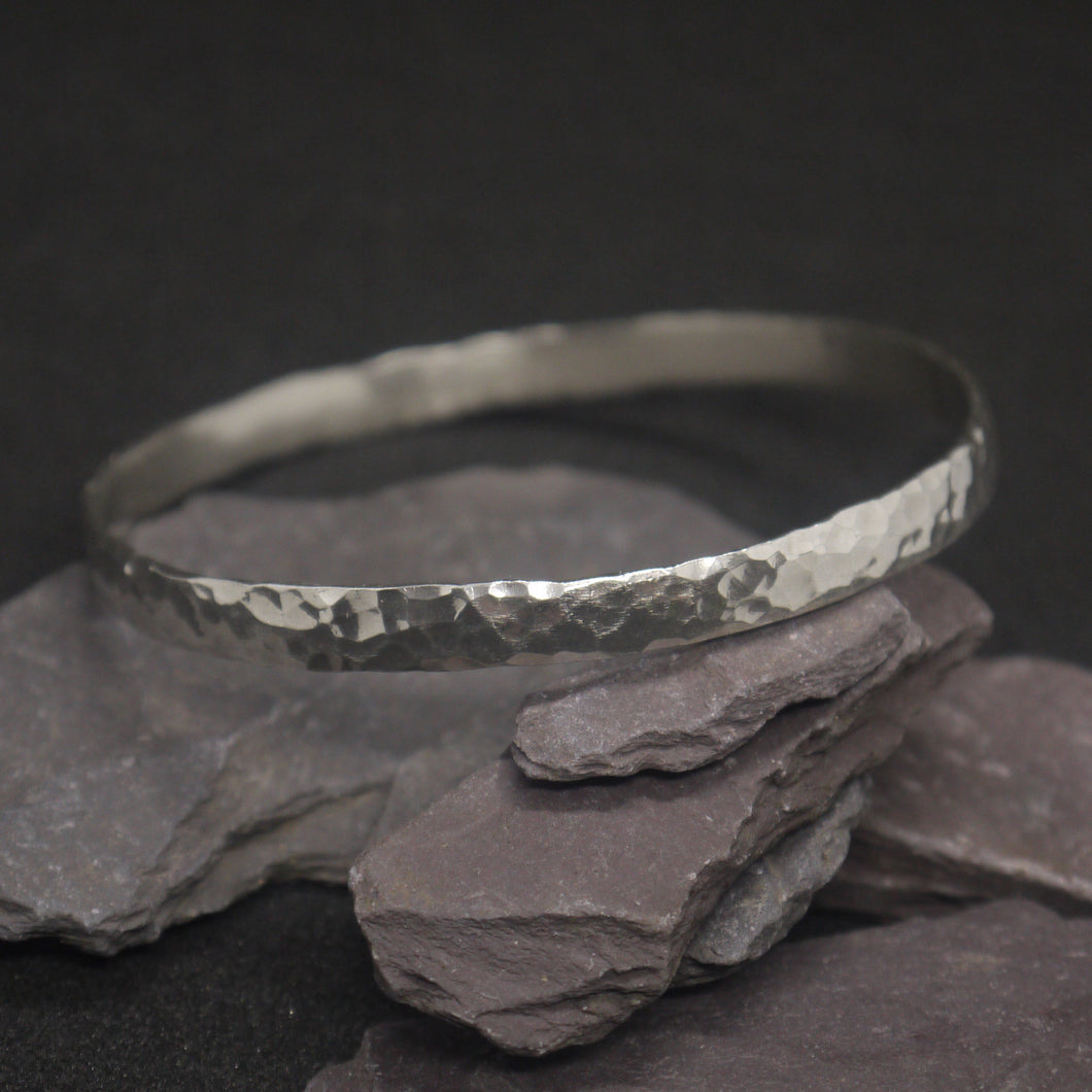 Round hammered solid silver bangle