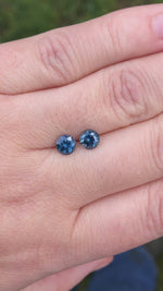 Load and play video in Gallery viewer, Montana Sapphire Matched Pair 1.73 Cts Round Cut Blue with Gray,Teal and Peach